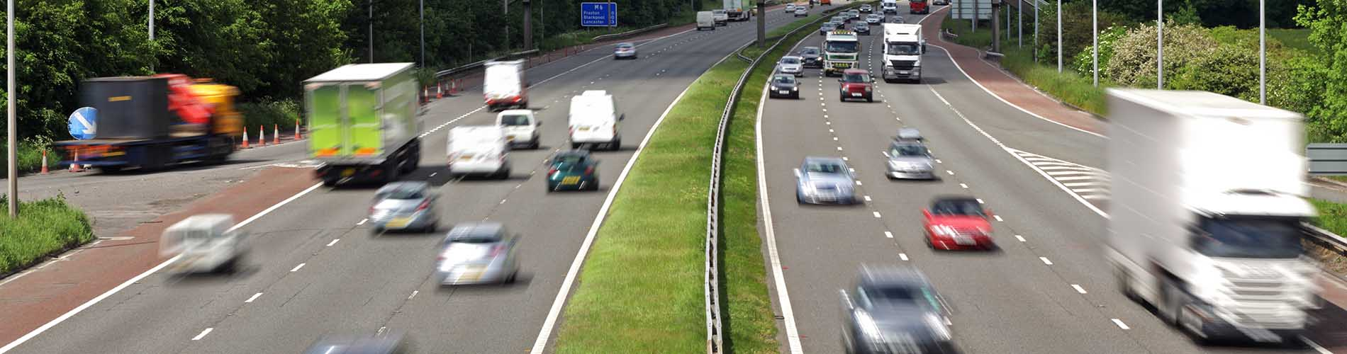 heavy traffic moving at speed on the motorway