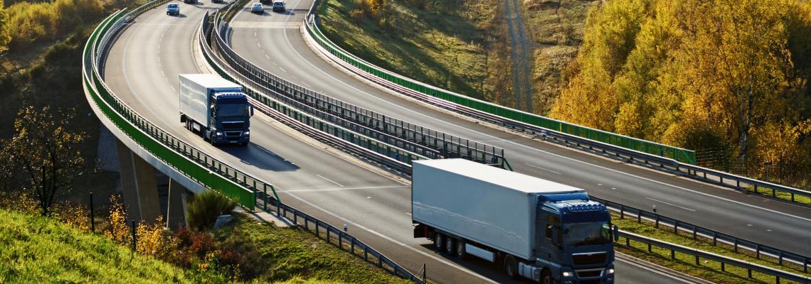 trucks highway green landscape
